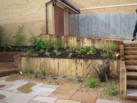 Timber sleeper beds and paving